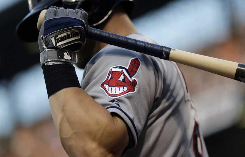 FILE - This June 26, 2015, file photo, shows the Cleveland Indians logo on a jersey during a baseball game against the Baltimore Orioles in Baltimore. Indians are taking the divisive Chief Wahoo logo off their uniforms and caps, starting in 2019.