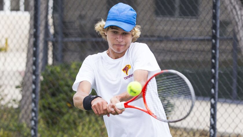 Torrey Pines' Nik Speshilov hits a backhand against Canyon Crest Academy during his second set.