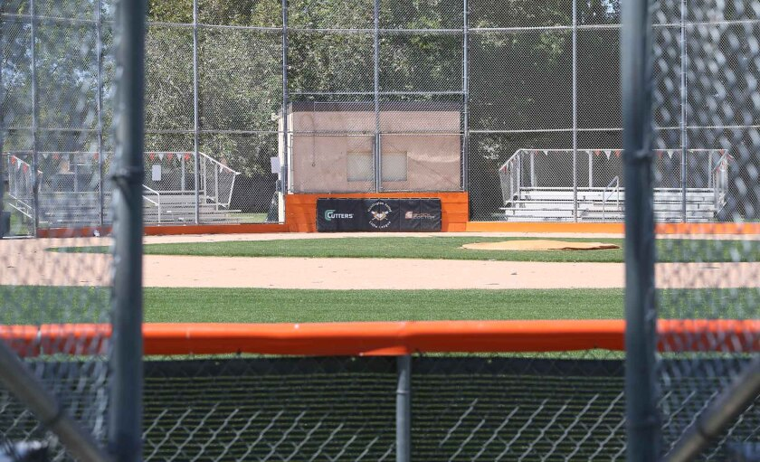 A Huntington Valley Little League field sits empty on Thursday in Huntington Beach. Little League International has recommended a suspension of all league activities through at least May 11.