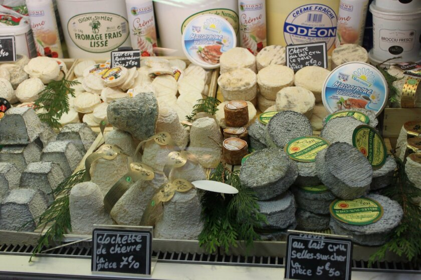 A Paris cheese shop offers a selection from each of the five main styles of cheese.
