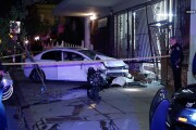 Erratic driver evades police then crashes into building