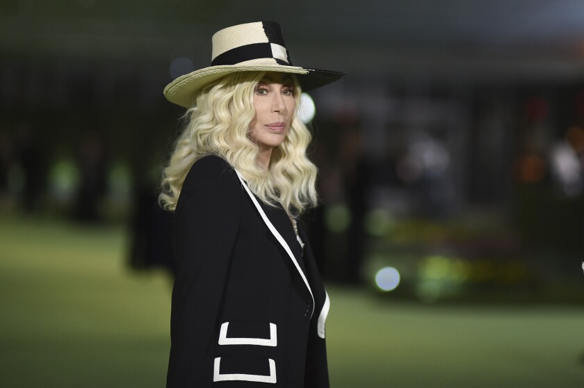 A blond woman in a wide-brimmed hat