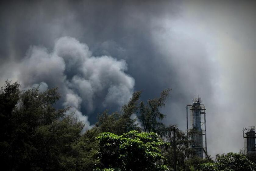 A plume of smoke rises above the Manguinhos refinery, located in the northern section of Rio de Janeiro and one of the few private oil refineries in Brazil, after a fire started at the complex on Dec. 17, 2018. EPA-EFE/Marcelo Sayao