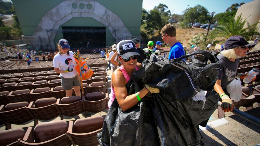 """Rochelle Brown of Carmel Mountain Ranch was one of nearly 300 community volunteers who took part in a """"reverse gardening"""" project to clean up the long-shuttered Starlight Bowl amphitheater in Balboa Park, which the city hopes to reopen and lease to a new"""