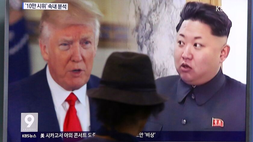 A man in Seoul, South Korea, watches a TV showing President Trump and North Korean leader Kim Jong Un.