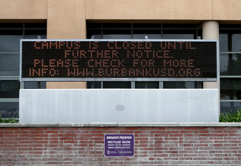 Burroughs High School is closed until further notice, according to an electronic board at the school in Burbank on Wednesday, April 8, 2020.