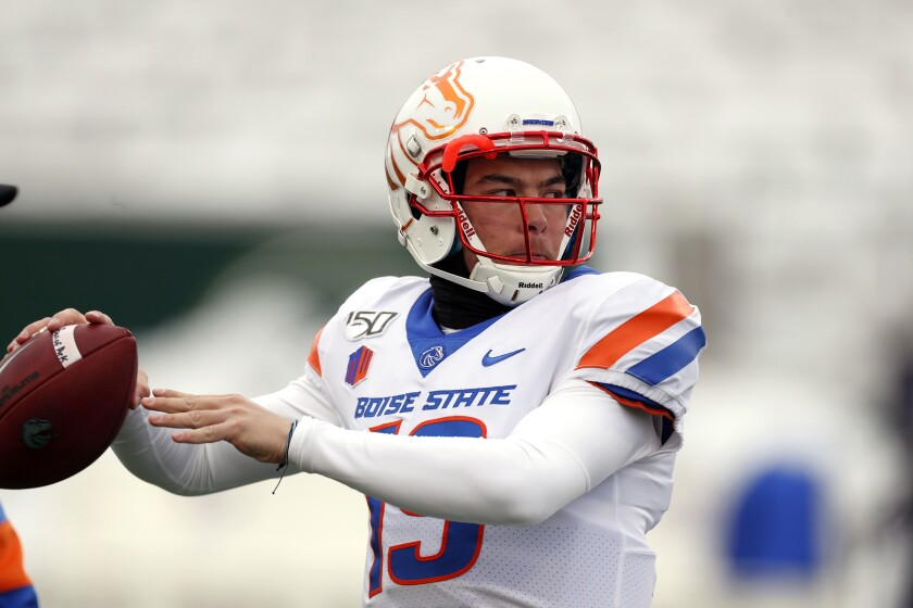 Boise State quarterback Hank Bachmeier (19) warms up before the first half of an NCAA college football game Friday, Nov. 29, 2019, in Fort Collins, Colo. For the second straight season, Bachmeier will be the starter when the Broncos open the season. (AP Photo/David Zalubowski)