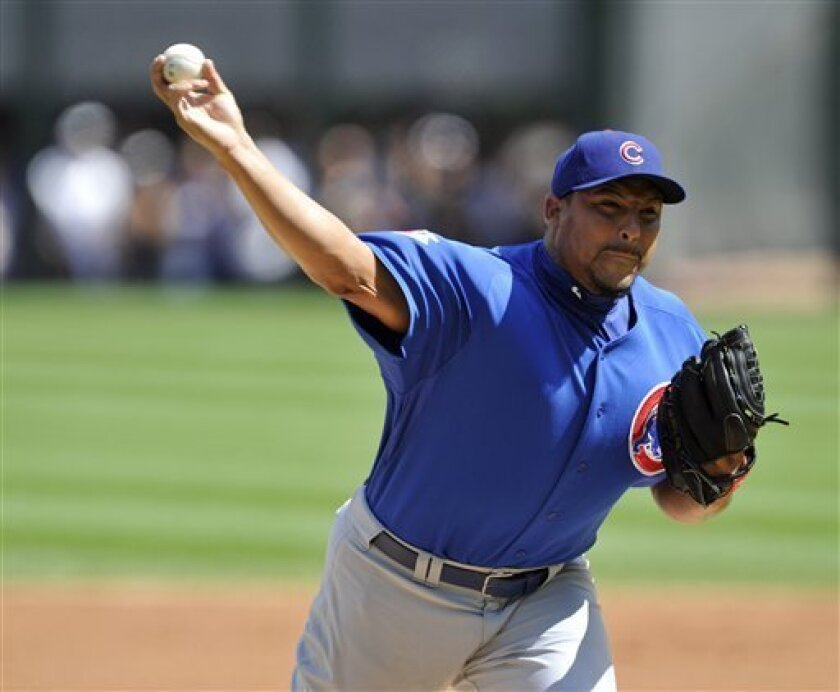 Chicago Cubs' Carlos Zambrano pitches against the Chicago White Sox during the first inning of a baseball game Friday, June 25, 2010, in Chicago. (AP Photo/Jim Prisching)