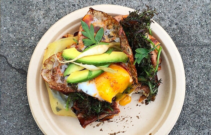 Wes Avila's duck egg and mortadella torta at Guerrilla Tacos. Hold the egg, please; not every dish needs one on top | Great dishes that taste better with an egg on top