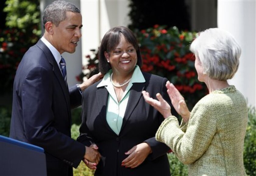 President Barack Obama, left, congratulates Dr. Regina Benjamin, center, as Secretary of Health and Human Services Kathleen Sebelius applauds, following Obama's announcement of his nomination of Benjamin to the post of Surgeon General, Monday, July 13, 2009, in the White House Rose Garden in Washington. (AP Photo/Haraz N. Ghanbari)