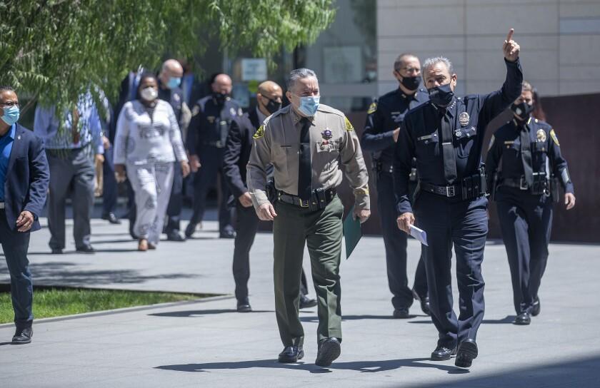 L.A. County Sheriff Alex Villanueva and LAPD Chief Michel Moore in masks