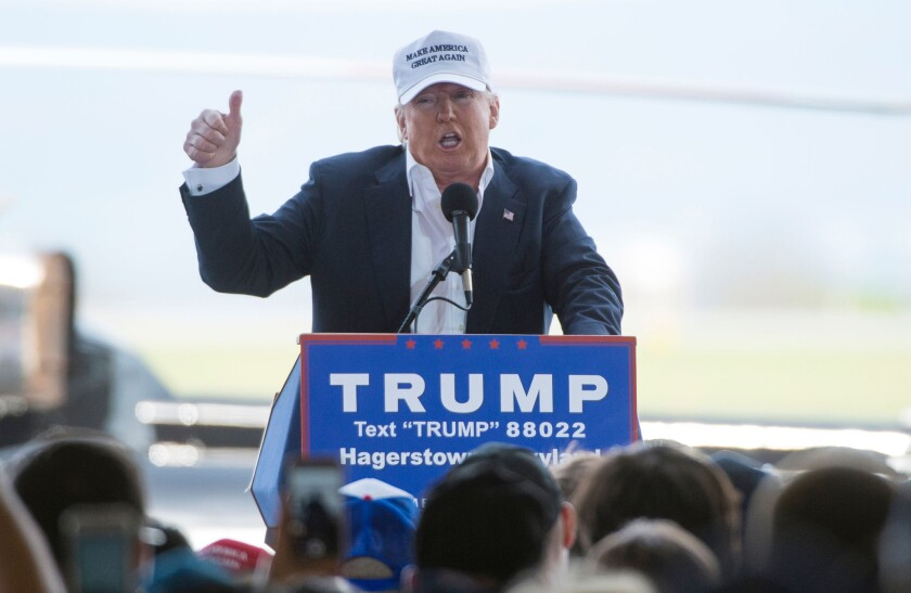 Republican presidential front-runner Donald Trump addresses a rally in an airplane hangar Sunday in Hagerstown, Md.