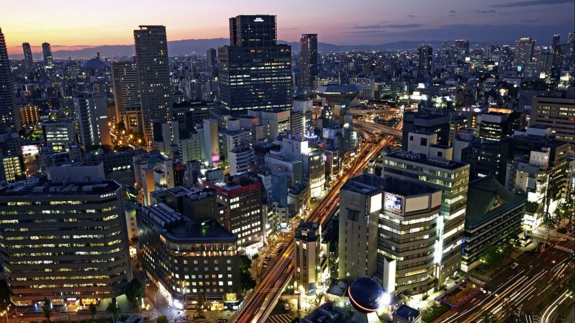 OSAKA, JAPAN: Skyline of Osaka as night arrives.