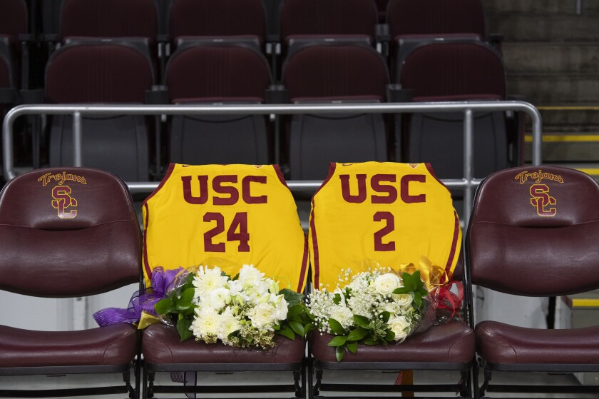 USC jerseys numbered for Kobe Bryant and his daughter Gianna displayed on the courtside seating before the game between USC and Utah on Thursday at Galen Center.