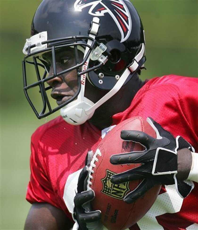 In this July 27, 2006 file photo, Atlanta Falcons running back Jerious Norwood hauls in a pass during a team workout in Flowery Branch, Ga.. Norwood, Atlanta's backup running back and kickoff return specialist, has suffered three concussions in his four years in the NFL. He also suffered a more serious concussion during his college career at Mississippi State, the only injury that knocked him out and forced him to be taken to a hospital. (AP Photo/John Bazemore)