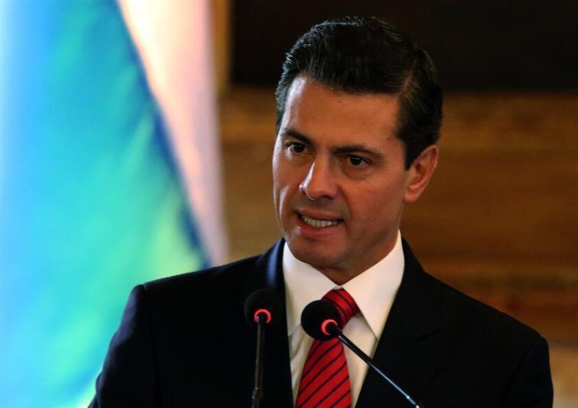 """El presidente de México, Enrique Peña Nieto, aseguró hoy que la celebración de siete rondas de negociaciones acreditan que las tres naciones firmantes del TLCAN, México, EE.UU. y Canadá, tienen """"voluntad"""" para llegar a un acuerdo para modernizar el convenio comercial. EFE/ARCHIVO"""