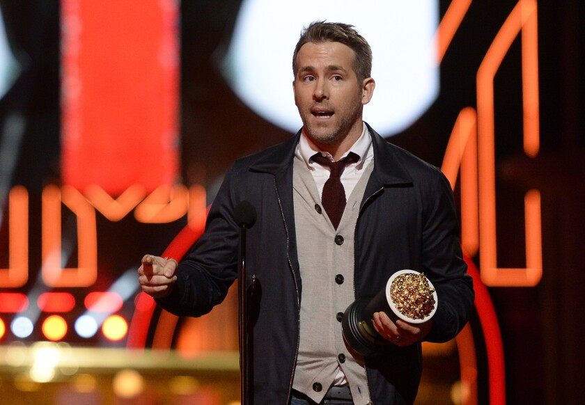 """Ryan Reynolds accepts an MTV Movie Award for best comedic performance for """"Deadpool"""" on April 9, 2016."""