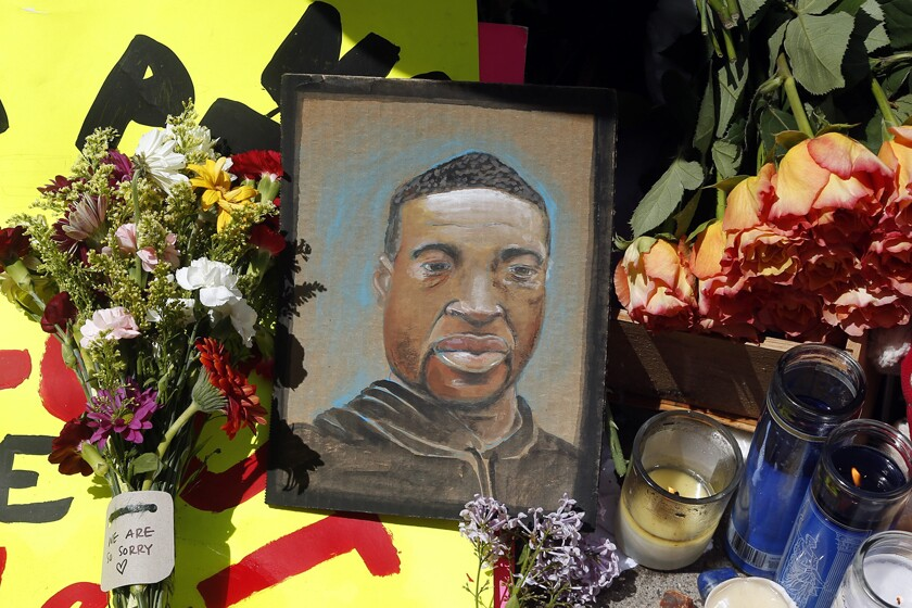 A portrait of George Floyd is displayed at a makeshift memorial for him in Minneapolis.