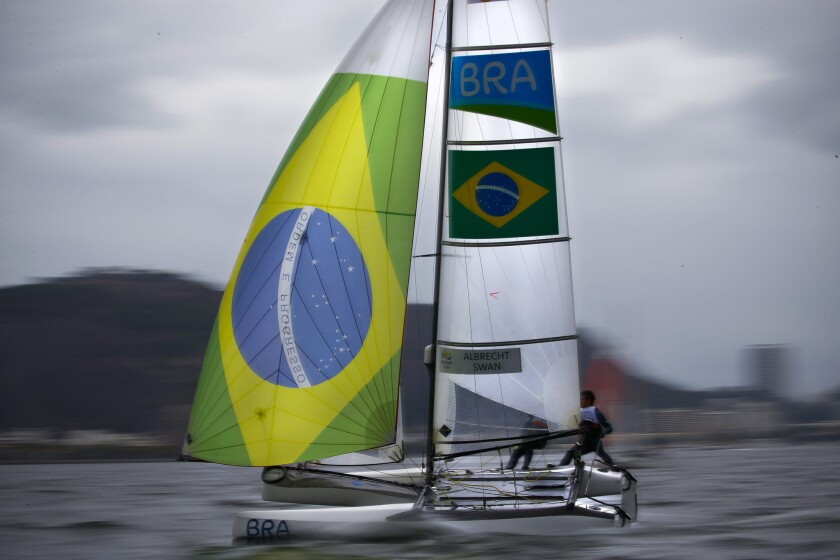 Samuel Albrecht and Isabel Swan from Brazil sail during the Nacra 17 mixed class race 01 in the Rio 2016 Olympic Games sailing events in Guanabara Bay on Aug. 10.