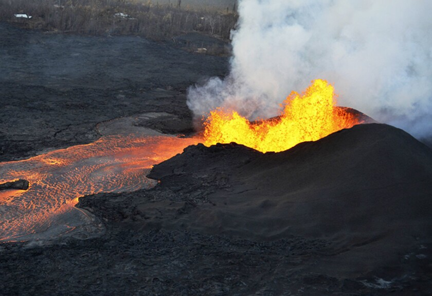 This photo provided by the U.S. Geological Survey shows lava fountaining at a fissure near Pahoa on