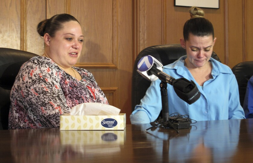 Amber McGuire, left, recounts the execution of her father, Dennis McGuire, as her sister-in-law Missie McGuire cries at a news conference on Friday when they announced a planned lawsuit against the state over the unusually slow execution.