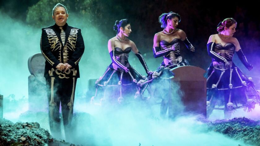 "Patton Oswalt, from left, Gabrielle Ruiz, Vella Lovell and Donna Lynne Champlin in a Halloween episode of ""Crazy Ex-Girlfriend"" on CW."