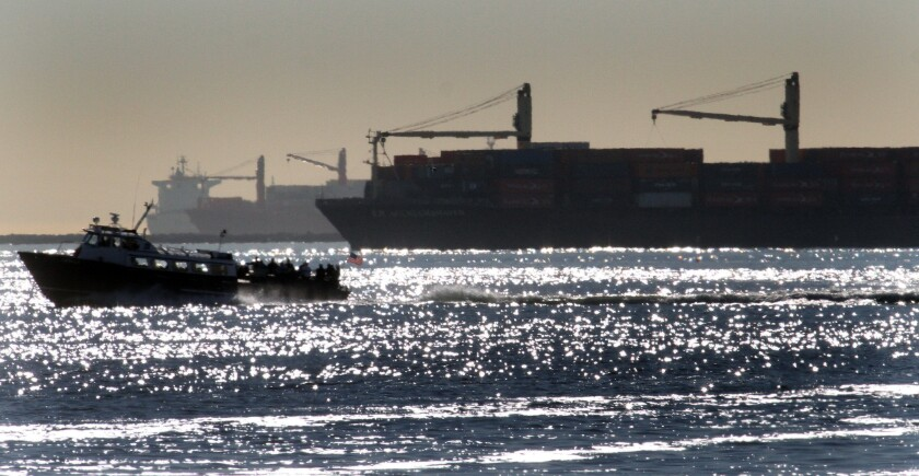 Container ships wait offshore to get into the Port of Long Beach on Feb. 11.