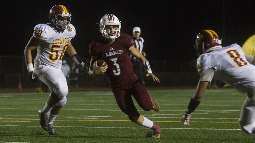 Ocean View High quarterback Noah Hickman, shown running the ball through Estancia's defense on Sept. 14, has passed for 11 touchdowns and rushed for nine scores this season.