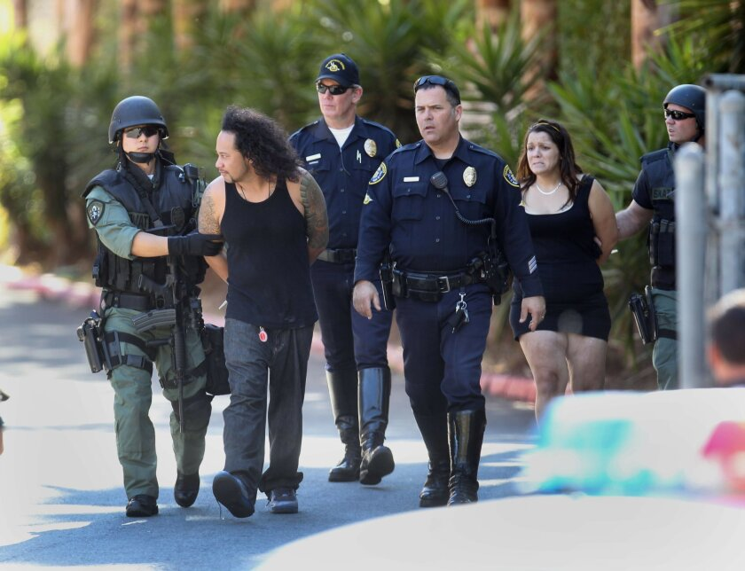 Members of the San Diego Fugitive Task force were met with what they thought was gunfire as they tried to apprehend 30 year-old Cecil Whiley. The SDPD SWAT team was called and after about a two hour stand off Whiley, second from left, and a woman in the room with him, second from right, gave up.