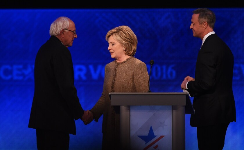 Democratic presidential hopefuls Bernie Sanders, Hillary Clinton and Martin O'Malley, from left, greet one another after their New Hampshire debate.
