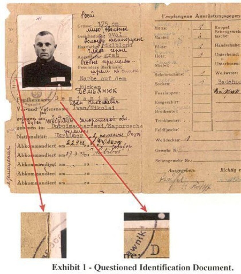 FILE - This file photo released by the Department of Justice on Feb. 21, 2002, shows a World War II-era military service pass for John Demjanjuk. The 89-year-old goes on trial Monday in Munich on 27,900 counts of accessory to murder following 30 years of legal efforts against Demjanjuk on three co