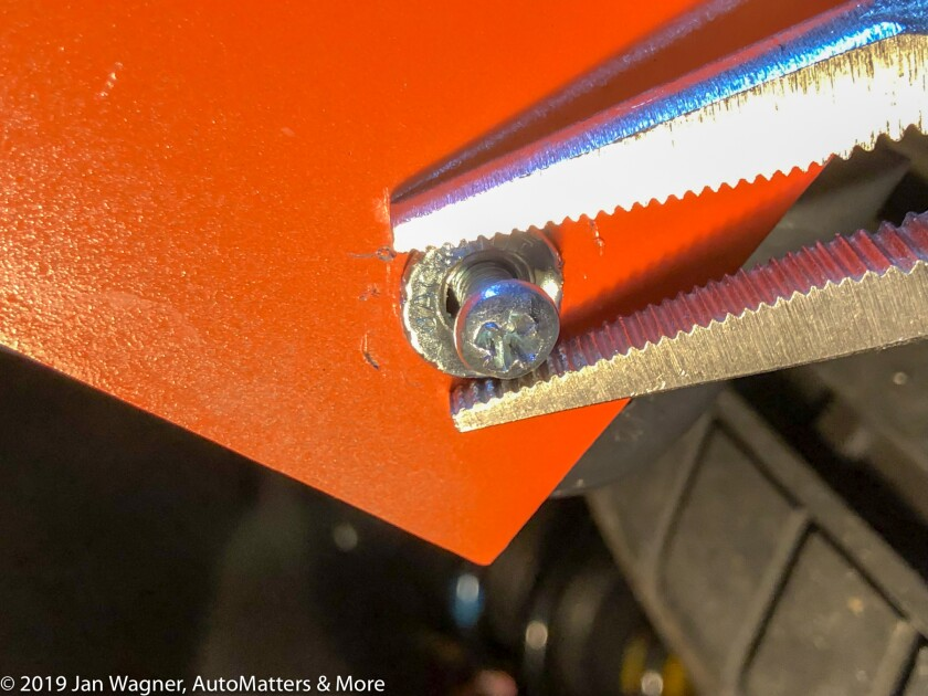 Holding the jack nut with Vise Grips to secure it by turning the screw