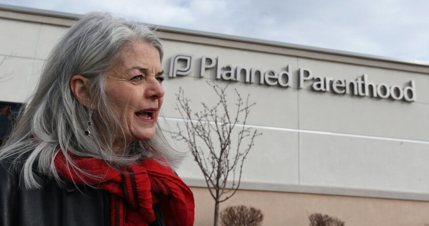 Vicki Cowart, president of Planned Parenthood of the Rocky Mountains addresses the media outside the Planned Parenthood building on Monday, Feb. 15, 2016, in Colorado Springs, Colo. Colorado Springs' Planned Parenthood clinic reopened Monday, nearly three months after a gunman killed three people a