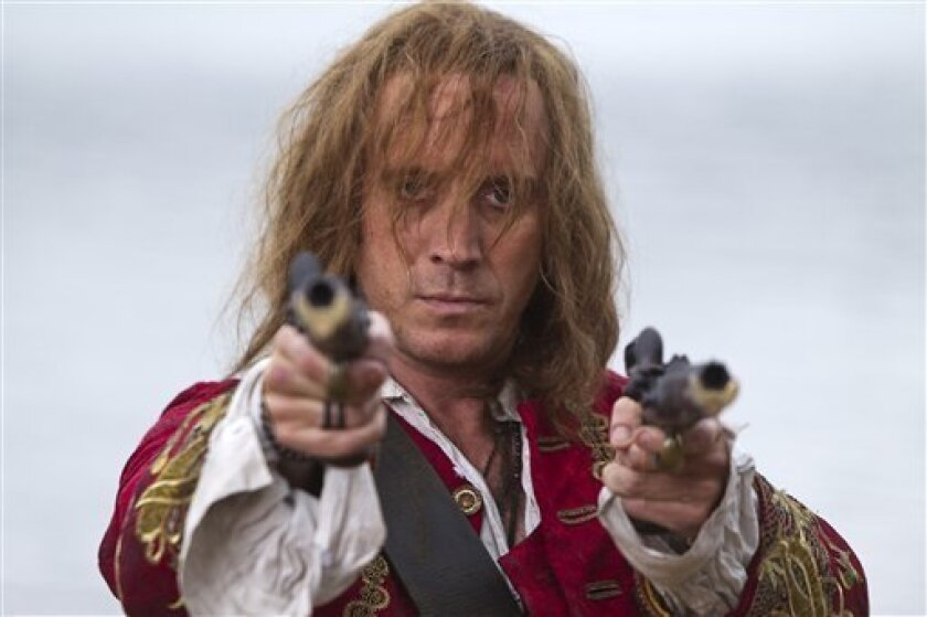 """In this handout phot provided by Syfy on Wednesday Nov. 3, 2010, British actor Rhys Ifans poses as the character Jimmy Hook on the set of new television movie """"Neverland"""" in Genoa, Italy, Thursday, Sept. 9, 2010. Ifans will also co-star as the villain in the next """"Spider-Man"""" film. (AP Photo/Syfy, Patrick Redmond)"""