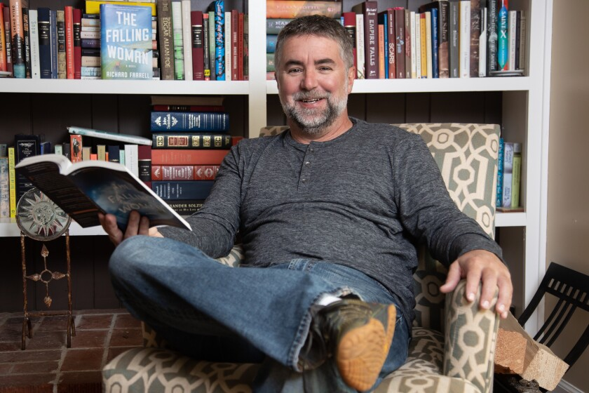 Author Richard Farrell poses for photos at his home in Point Loma.