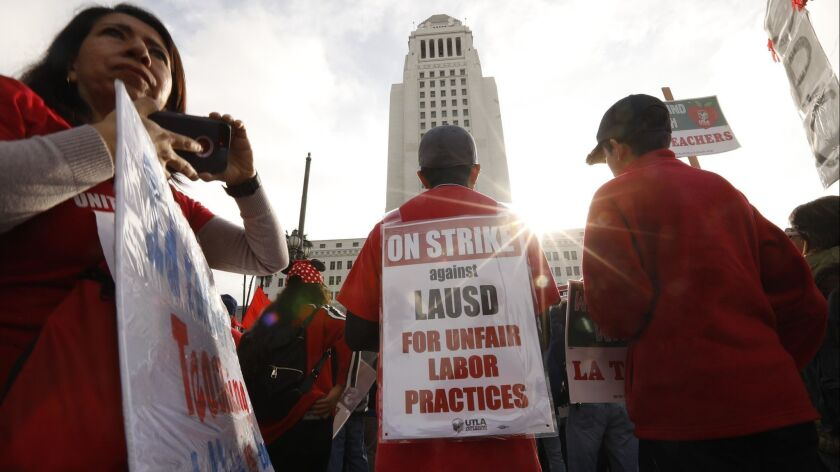 Teacher Yanira Estrada, left, of Sally Ride Elementary, is among strikers who rallied Friday outside City Hall, where talks are ongoing to settle the walkout by United Teachers Los Angeles.