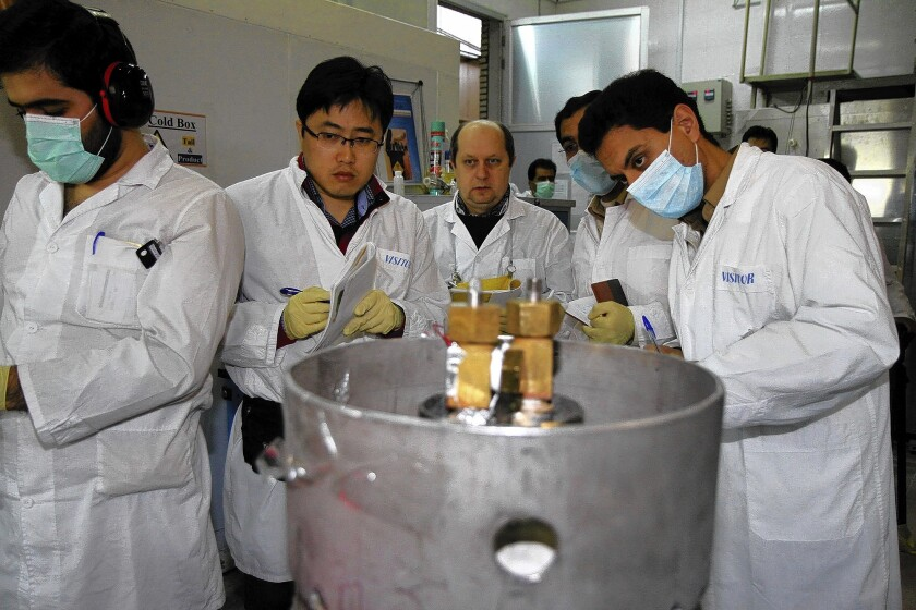 International Atomic Energy Agency inspectors and Iranian technicians are on hand to cut the connections between the twin cascades for 20% uranium enrichment at the Natanz nuclear facility in Iran.