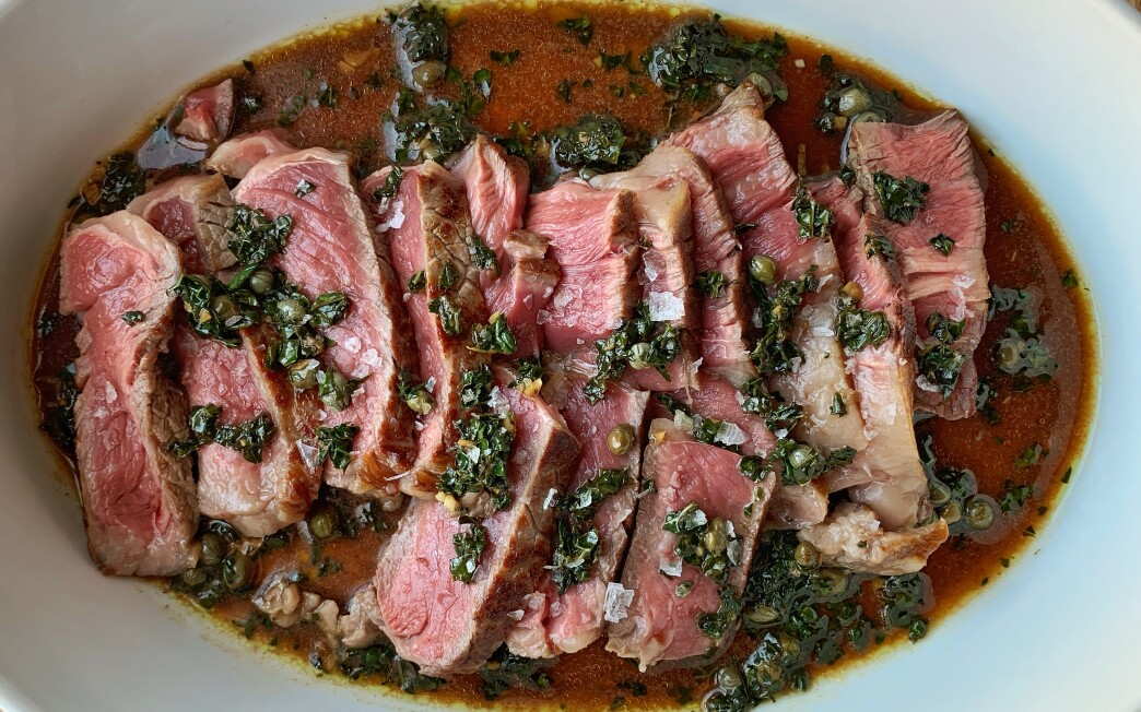 An umami-packed green sauce made with kale and capers seasons expertly cooked steaks at home.