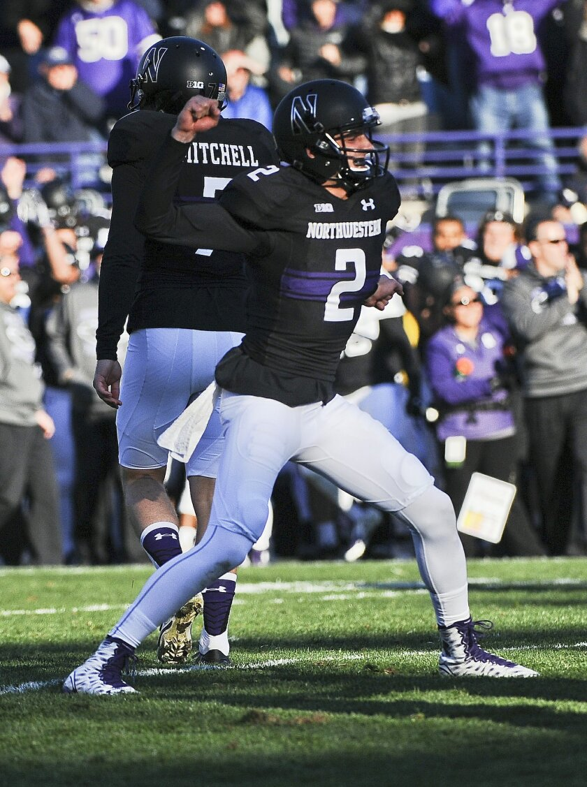 Northwestern wide receiver Christian Salem (2) reacts after Northwestern place kicker Jack Mithchell (7) kicked the game-winning field goal in the closing second of the second half of an NCAA college football game against Penn State in Evanston, Ill.,  Saturday, Nov. 7, 2015.  Northwestern beat Pen