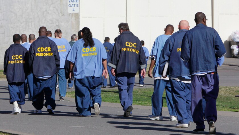 Prisoners walk through the exercise yard at California State Prison Sacramento, near Folsom, in 2013.