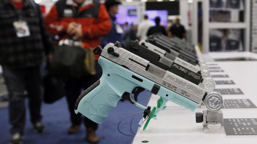 Handguns are on display at the NRA convention in Dallas, Friday, May 4, 2018. Oklahoma's Republican