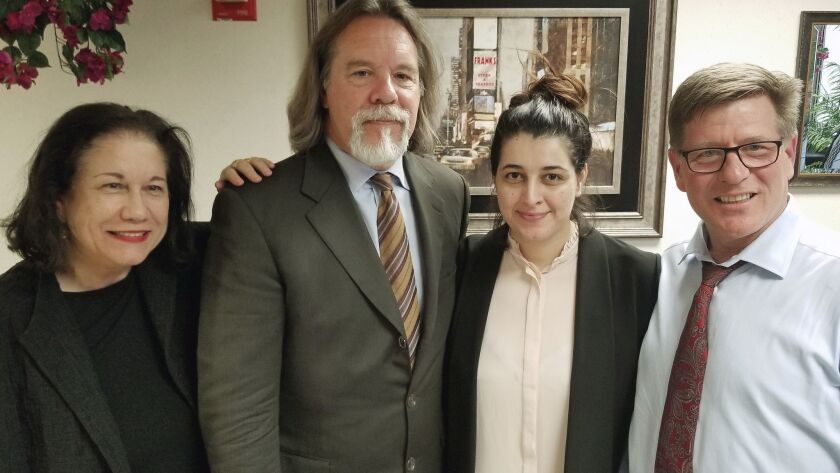 In this Friday, March 30, 2018 photo released by Susan Clary, Noor Salman, second from right, and he