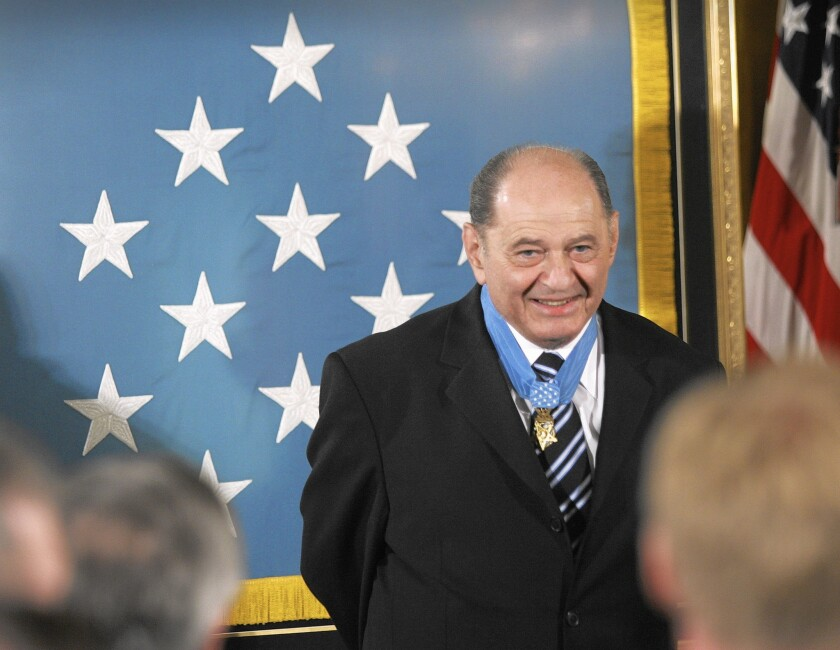 Tibor Rubin receives a standing ovation in the East Room of the White House on Sept. 23, 2005, upon receiving the Medal of Honor from President George W. Bush.