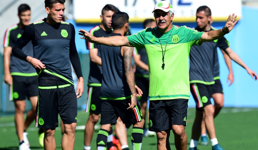 Mexico Coach Ricardo Ferretti gestures as his players take part in a training session at the Rose Bowl on Friday.