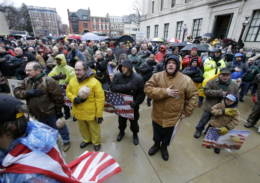 """A large gathering says the Pledge Of Allegiance in Trenton, N.J., at a rally outside the New Jersey Statehouse last year. An atheist family in the state is challenging a state law requiring the pledge be recited in schools because of its inclusion of the phrase """"under God."""""""