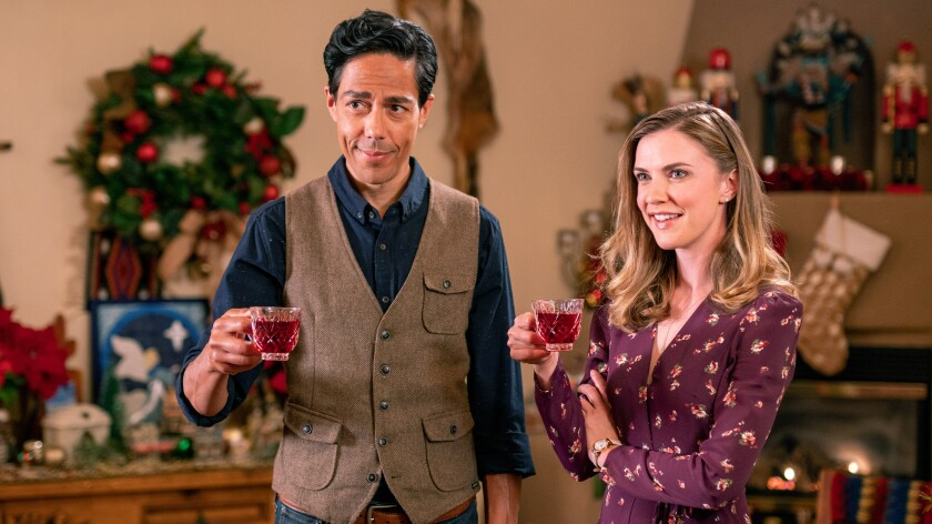 """Zak Santiago and Sara Canning in """"The Christmas Yule Blog"""" on Lifetime."""