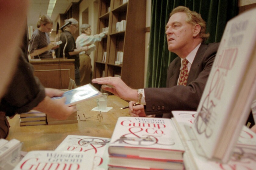 """Winston Groom signs copies of """"Gump & Co.,"""" the sequel to """"Forrest Gump"""", at a New York City bookstore in 1995."""