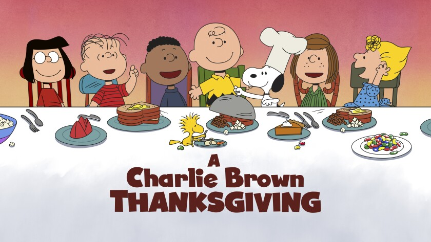 "This image released by Apple shows key art for the animated classic ""A Charlie Brown Thanksgiving"" holiday special."