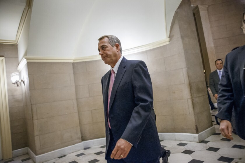 House Speaker John Boehner (R-Ohio) walks to the House chamber on Capitol Hill on Tuesday. The House passed a bill to fund the Department of Homeland Security without provisions rejecting President Obama's executive actions on immigration.