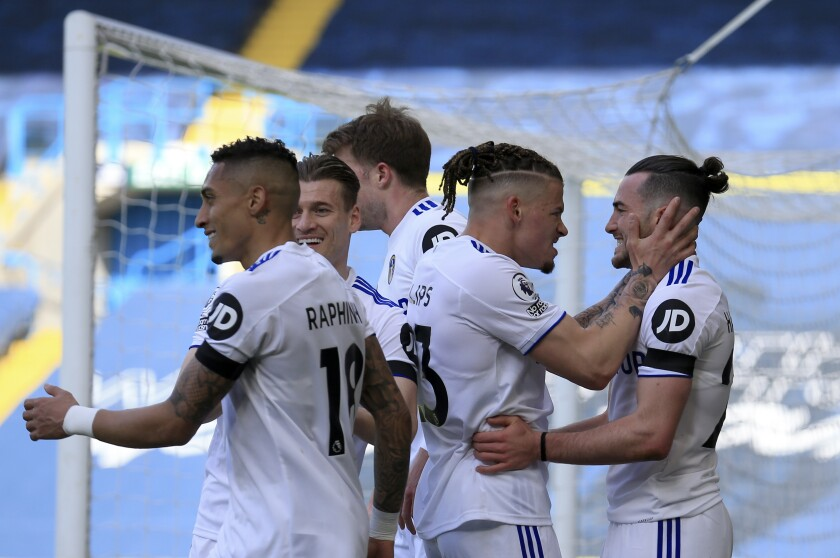Leeds United's Jack Harrison, right, celebrates with teammates after scoring his side's opening goal during the English Premier League soccer match between Leeds United and Sheffield United at Elland Road Stadium in Leeds, England, Saturday, April 3, 2021. (Lindsey Parnaby/Pool via AP)